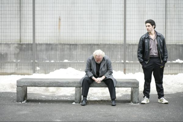 Malik El Djebena (Tahar Rahim) stands beside César Luciani (Niels Arestrup) in the yard of the French prison where they are incarcerated. Courtesy of Sony Pictures Classics.