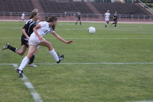 Take that, Tigers: Abby Diamond (11) evades a Lick-Wilmerding High School player during a recent game.