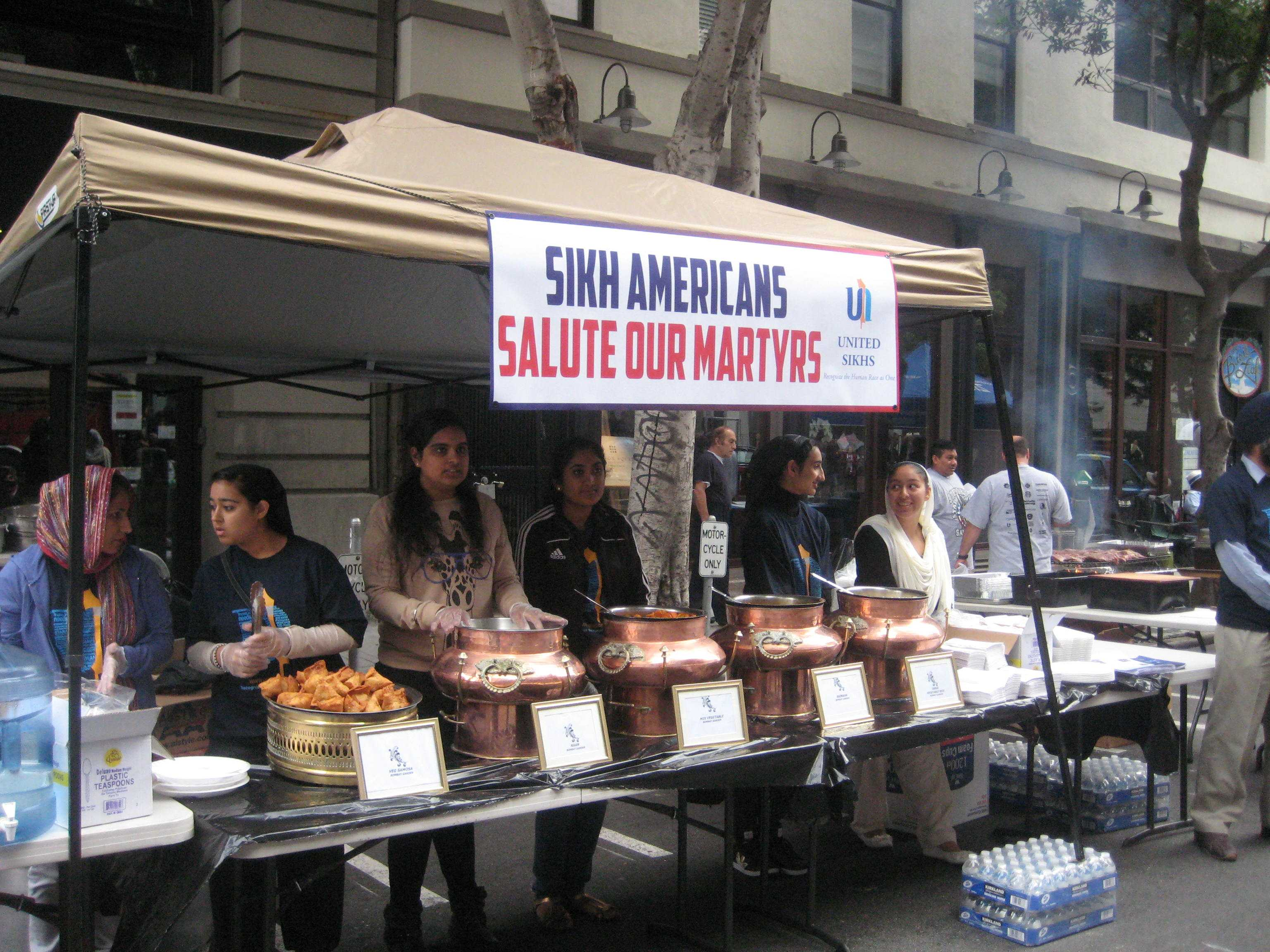 Sikhs from Fremont, Calif., serve food on Sunday, Sept. 11 at the Transamerica Pyramid to support The National Fallen Firefighters Foundation.