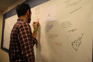 David Bill, Urban's director of technology, writes on his Steve Jobs memorial wall on Oct. 6.