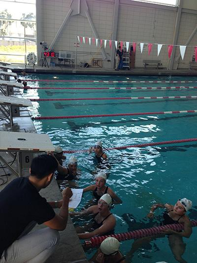 Coach Liu talks with his team before the meet.