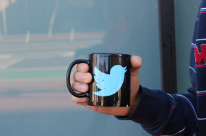 A Twitter employee who requested to remain anonymous shows off his Twitter mug on a smoking break. During the IPO, the majority of the Twitter employees spotted sported clothing with the bright blue bird.