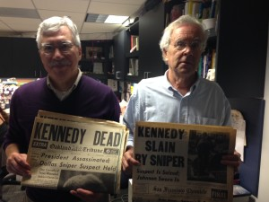 Dan Murphy and LeRoy Votto holding newspapers from the day after the Kennedy assassination