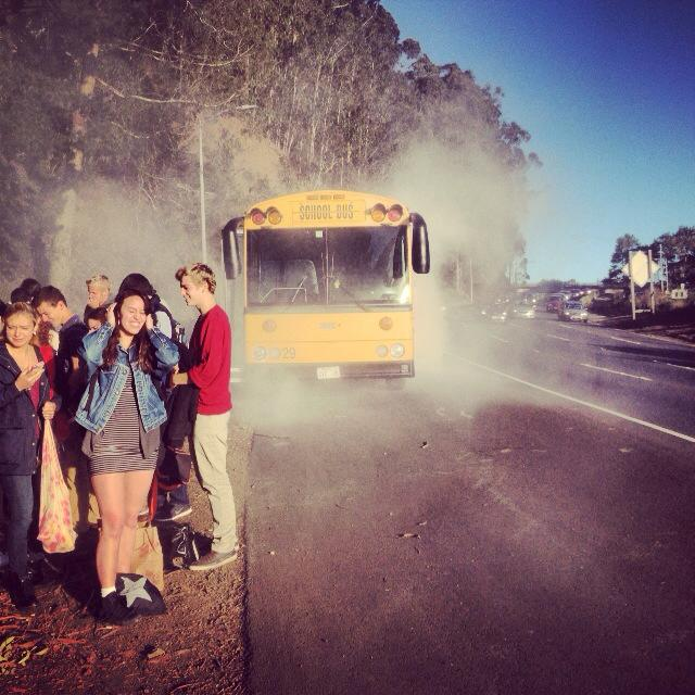 Urban+students+on+Tuesday+morning+stand+on+the+side+of+the+Redwood+Highway%2C+north+of+the+Rainbow+Tunnel+that+leads+to+the+Golden+Gate+Bridge.+Students+were+asked+to+evacuate+the+bus+after+an+engine+fire+caused+smoke+to+appear+from+the+back+left+of+the+bus.