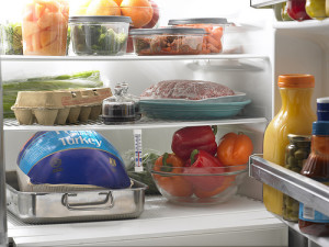 Photo from USDA food blog shows a refrigerator stocked with many items that CalFresh recipients may not be able to buy, such as red peppers, eggs, olives, and assorted condiments.
