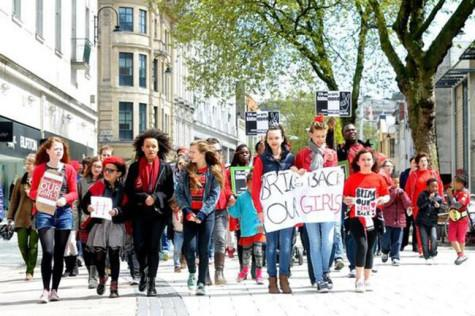 Campaigners march in Cardiff, the capital of Wales, as a part of