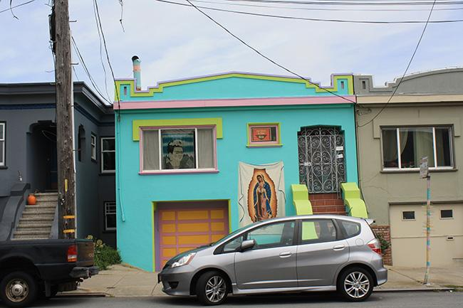 This house, along with it's vibrant colors and décor, is located on Gennessee St. at Judson Ave.