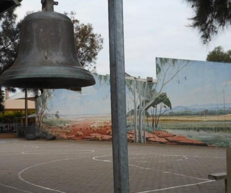 An old school bell sits in the courtyard of a school photo by Michael Coghlan