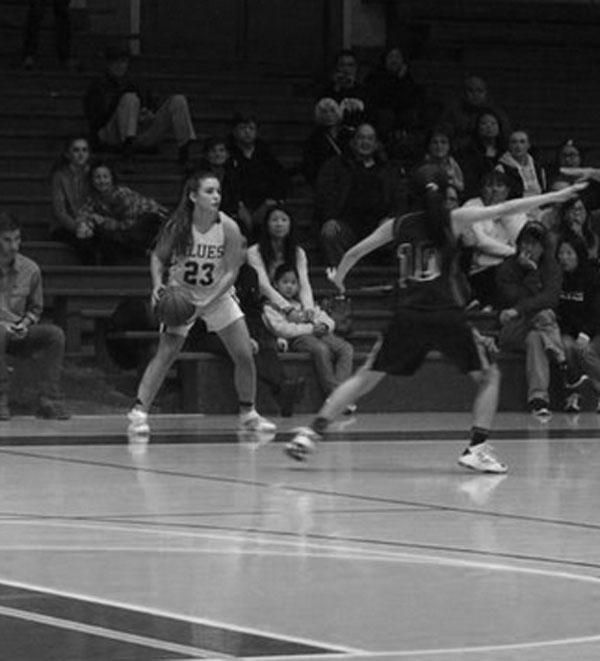 Natalie Sears (15) inbounds the ball vs. league opponent Lick-Wilmerding
