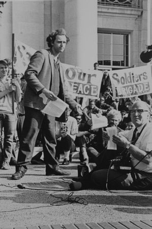 Mario Savio hands out flyers at a protest.