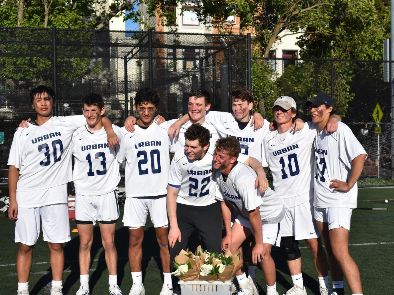 Urban boys lacrosse players gather for a photo after a game. Photo credit: Tikloh Bruno-Basaing.