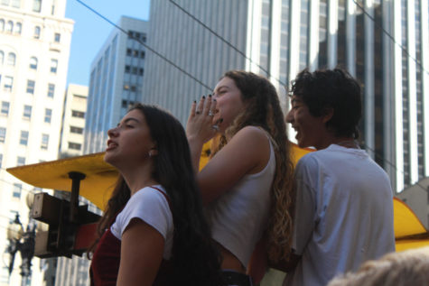 A San Francisco student, Calista Nicholson '21, and Elijah Leshnick '21 protest at the Climate March on Friday, September 20, 2019. Photo Credit: Phoebe Grandi.