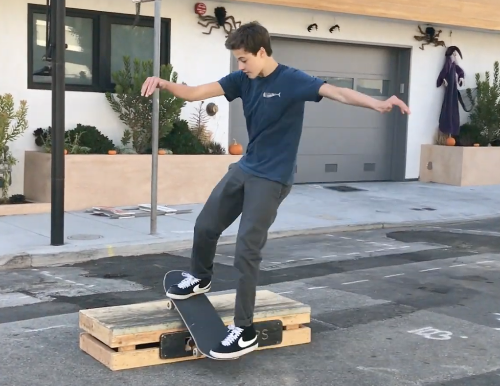 Jeremiah Lerner '23 skateboarding in the street. Photo credit: Jeremiah Lerner.