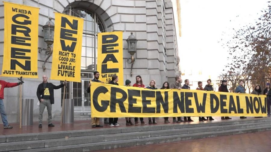 Progressive+climate+justice+group+Sunrise+Movement+protests+outside+a+government+building.+Photo+credit%3A+Sunrise+Movement.